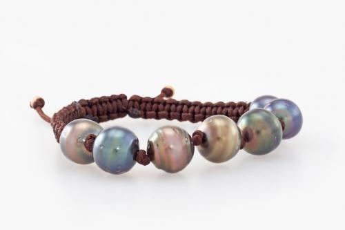7 pearl Fiji bracelet on brown cord.
